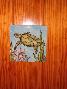 Each stateroom has a hand painted tile on the cabin door.